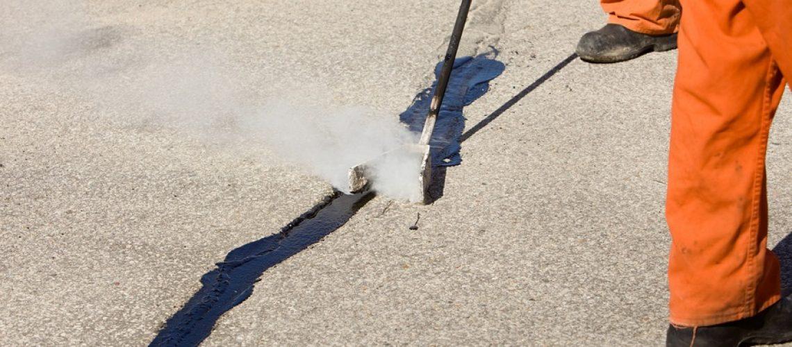 Hot Tar Asphalt Road Crack Repair